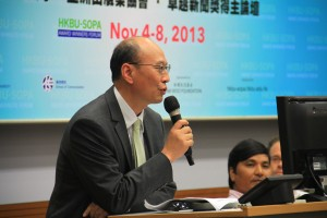 Hong Kong Baptist University School of Communication Dean Huang Yu opens hte forum. Photo: Song Cheng